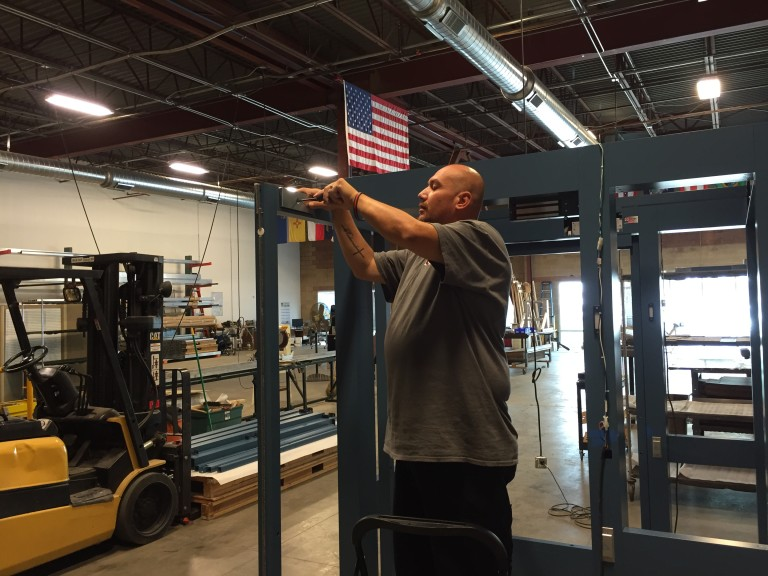 Isaac Madrid performing factory acceptance testing access control vestibule for US Air Force